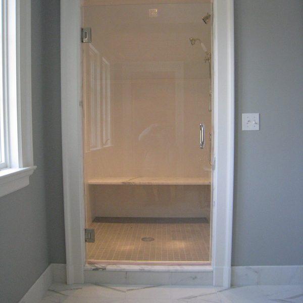 Bathroom with tile and door