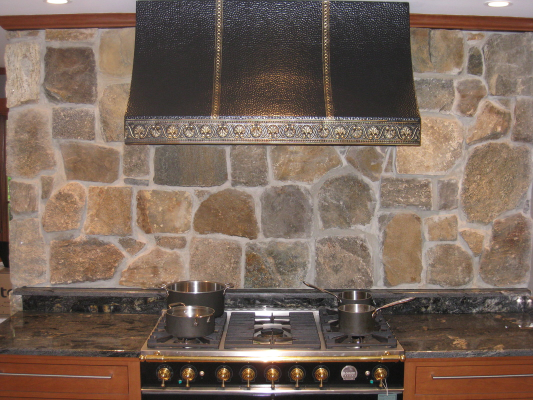 Stovetop with stone back and hood
